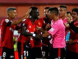 Lago Junior is mobbed by Mallorca teammates after scoring against Real Madrid on October 19, 2019