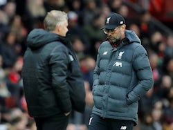 Jurgen Klopp and Ole Gunnar Solskjaer prowl their respective areas during the Premier League game between Manchester United and Liverpool on October 20, 2019