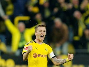 Marco Reus scores again as Dortmund win Borussia derby