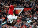 Marcus Rashford scores the opener during the Premier League game between Manchester United and Liverpool on October 20, 2019