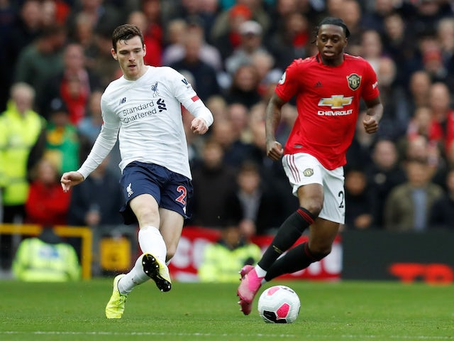 Andrew Robertson and Aaron Wan-Bissaka in action during the Premier League game between Manchester United and Liverpool on October 20, 2019