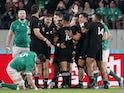 New Zealand's Aaron Smith celebrates with team mates scoring their first try on October 19, 2019