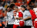Kansas City Chiefs quarterback Patrick Mahomes (15) is helped off the field after a play in the second quarter against the Denver Broncos at Empower Field at Mile High on October 18, 2019