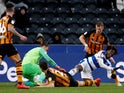 Queens Park Rangers' Ebere Eze goes down in the penalty area in March 2019