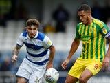 Queens Park Rangers midfielder Ryan Manning in action with West Bromwich Albion midfielder Jake Livermore on September 28, 2019