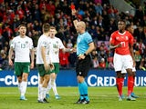 Republic of Ireland's Seamus Coleman is shown a red card by referee Szymon Marciniak on October 15, 2019