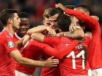 Switzerland's Edimilson Fernandes celebrates scoring their second goal with Granit Xhaka and team mates on October 15, 2019