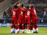 Alex Oxlade-Chamberlain celebrates his early opener during the Champions League game between Genk and Liverpool on October 23, 2019