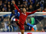 Virgil van Dijk and Paul Onuachu in action during the Champions League game between Genk and Liverpool on October 23, 2019