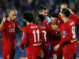 Alex Oxlade-Chamberlain is mobbed by teammates after getting the second during the Champions League game between Genk and Liverpool on October 23, 2019