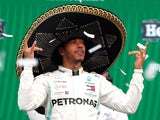 Lewis Hamilton celebrates winning the race on the podium whilst wearing a sombrero on October 27, 2019