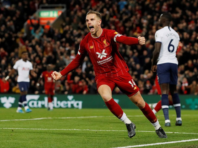 Liverpool's Jordan Henderson celebrates scoring against Tottenham Hotspur in the Premier League on October 27, 2019