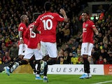 Manchester United's Anthony Martial celebrates scoring their third goal with team mates on October 27, 2019