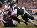New England Patriots running back Sony Michel (26) dives for a touchdown against New York Jets linebacker C.J. Mosley (57) during the second quarter at MetLife Stadium on October 22, 2019