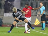 Manchester United's Aaron Wan-Bissaka in action with Partizan Belgrade's Takuma Asamo in the Europa League on October 24, 2019
