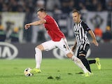 Manchester United's Phil Jones in action with Partizan Belgrade's Bibras Natcho in the Europa League on October 24, 2019