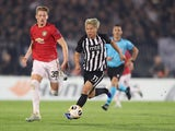 Manchester United's Scott McTominay in action with Partizan Belgrade's Takuma Asamo in the Europa League on October 24, 2019