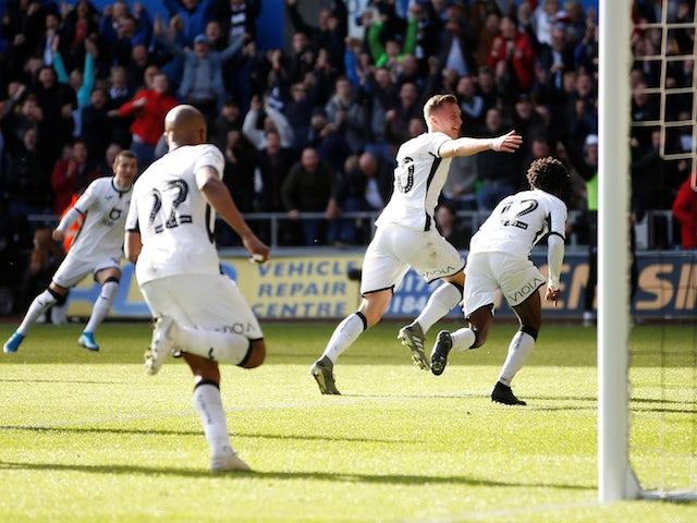 Swansea City's Ben Wilmot celebrates scoring their first goal against Cardiff on October 27, 2019