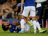 Everton's Andre Gomes reacts after sustaining an injury against Tottenham Hotspur on November 3, 2019
