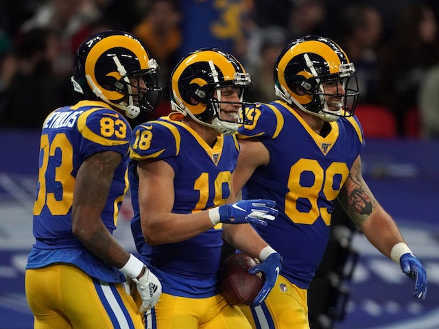 Los Angeles Rams wide receiver Cooper Kupp (18) celebrates with tight end Tyler Higbee (89) and receiver Josh Reynolds (83) after scoring on a 65-yard touchdown reception in the second quarter against the Cincinnati Bengals during an NFL International Ser