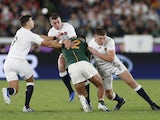 outh Africa's Damian de Allende in action with England's Owen Farrell, George Ford and Ben Youngs on November 2, 2019