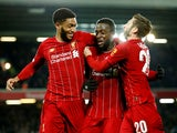 Liverpool's Divock Origi celebrates scoring their fifth goal with teammates Joe Gomez and Adam Lallana on October 30, 2019