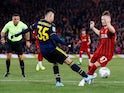 Liverpool's Harvey Elliott goes down under the challenge of Arsenal's Gabriel Martinelli prompting referee Andre Marriner to award Liverpool a penalty on October 30, 2019
