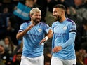 Manchester City's Sergio Aguero celebrates scoring their third goal with Nicolas Otamendi on October 29, 2019