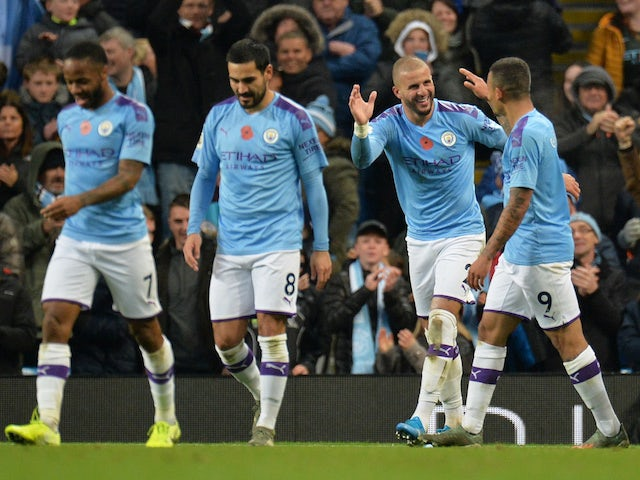 Manchester City's Kyle Walker celebrates scoring their second goal with Gabriel Jesus and teammates on November 2, 2019