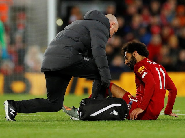 Liverpool's Mohamed Salah receives medical attention after sustaining an injury on October 27, 2019