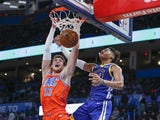 Oklahoma City Thunder forward Mike Muscala (33) dunks in front of Golden State Warriors guard Jordan Poole (3) during the second half at Chesapeake Energy Arena