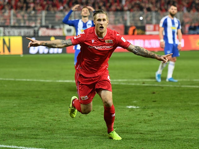 Union Berlin's Sebastian Polter celebrates scoring their first goal against Hertha Berlin on November 2, 2019