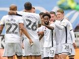 Swansea City's Nathan Dyer celebrates scoring their first goal with teammates