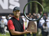Tiger Woods holds a winning trophy as he celebrates to win the Zozo Championship, a PGA Tour event, at Narashino Country Club in Inzai, Chiba Prefecture, east of Tokyo, Japan on October 28, 2019