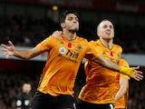 Wolverhampton Wanderers' Raul Jimenez celebrates scoring their first goal with Diogo Jota on November 2, 2019