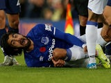 Everton's Andre Gomes reacts after sustaining an injury on November 3, 2019