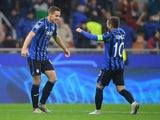 Atalanta's Mario Pasalic celebrates scoring their first goal with Alejandro Gomez on November 6, 2019