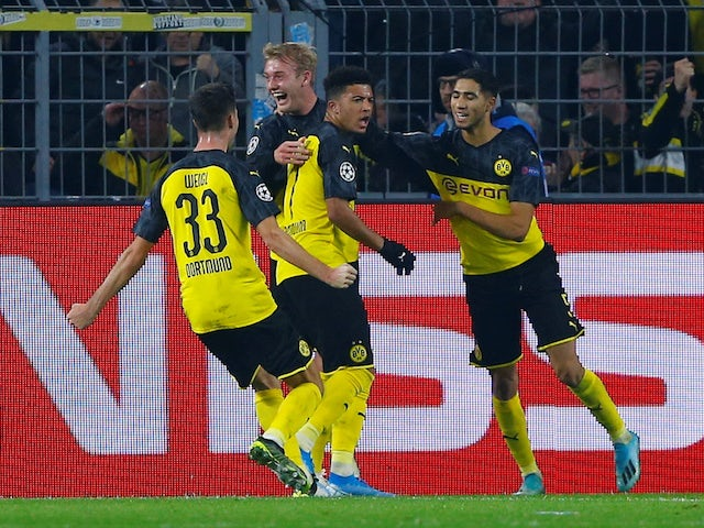 Dortmund's Julian Brandt celebrates scoring their second goal with team mates on November 5, 2019