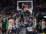 Boston Celtics center Robert Williams III (44) dunks the ball over San Antonio Spurs guard Derrick White (4) and forward LaMarcus Aldridge (12) during the second half at the AT&T Center on November 10, 2019.