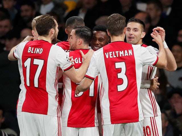 Ajax's Quincy Promes celebrates scoring their first goal with teammates on November 5, 2019