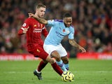 Liverpool midfielder Jordan Henderson in action with Manchester City's Raheem Sterling in the Premier League on November 10, 2019