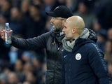 Manchester City manager Pep Guardiola and Liverpool manager Juergen Klopp talk to each other during the match in January 2019