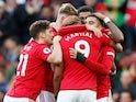 Manchester United's Andreas Pereira celebrates scoring their first goal with teammates on November 10, 2019