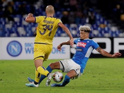Hellas Verona's Sofyan Amrabat in action with Napoli's Kevin Malcuit in Serie A on October 19, 2019