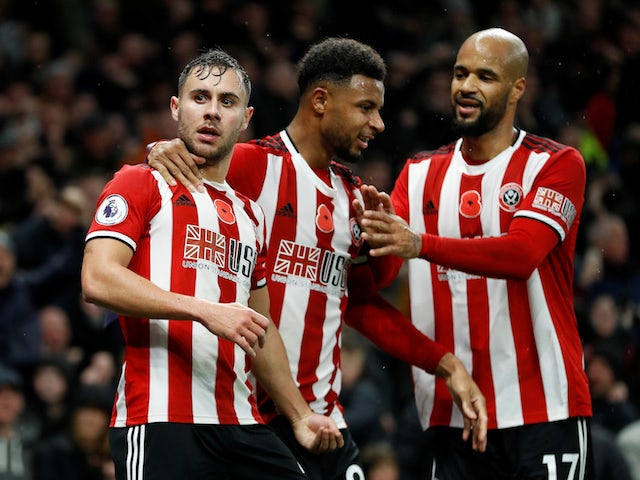 Sheffield United's George Baldock celebrates scoring their first goal with Lys Mousset and David McGoldrick on November 9, 2019
