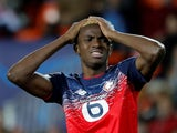 Lille's Victor Osimhen looks dejected after Valencia's Dani Parejo scores their first goal on November 5, 2019