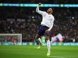 England's Alex Oxlade-Chamberlain celebrates on November 14, 2019