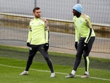 Manchester City's Bernardo Silva and Benjamin Mendy during training in November 2019