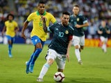 Argentina's Lionel Messi in action with Brazil's Alex Sandro on November 15, 2019