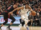Milwaukee Bucks forward Giannis Antetokounmpo (34) dribbles the ball past Chicago Bulls forward Thaddeus Young (21) during the third quarter at Fiserv Forum on November 15, 2019